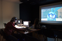 Petersburg Animation Studio director Denis Chernov watching stereo material